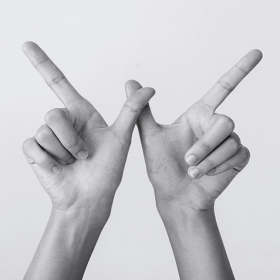 Two hands form a W.
