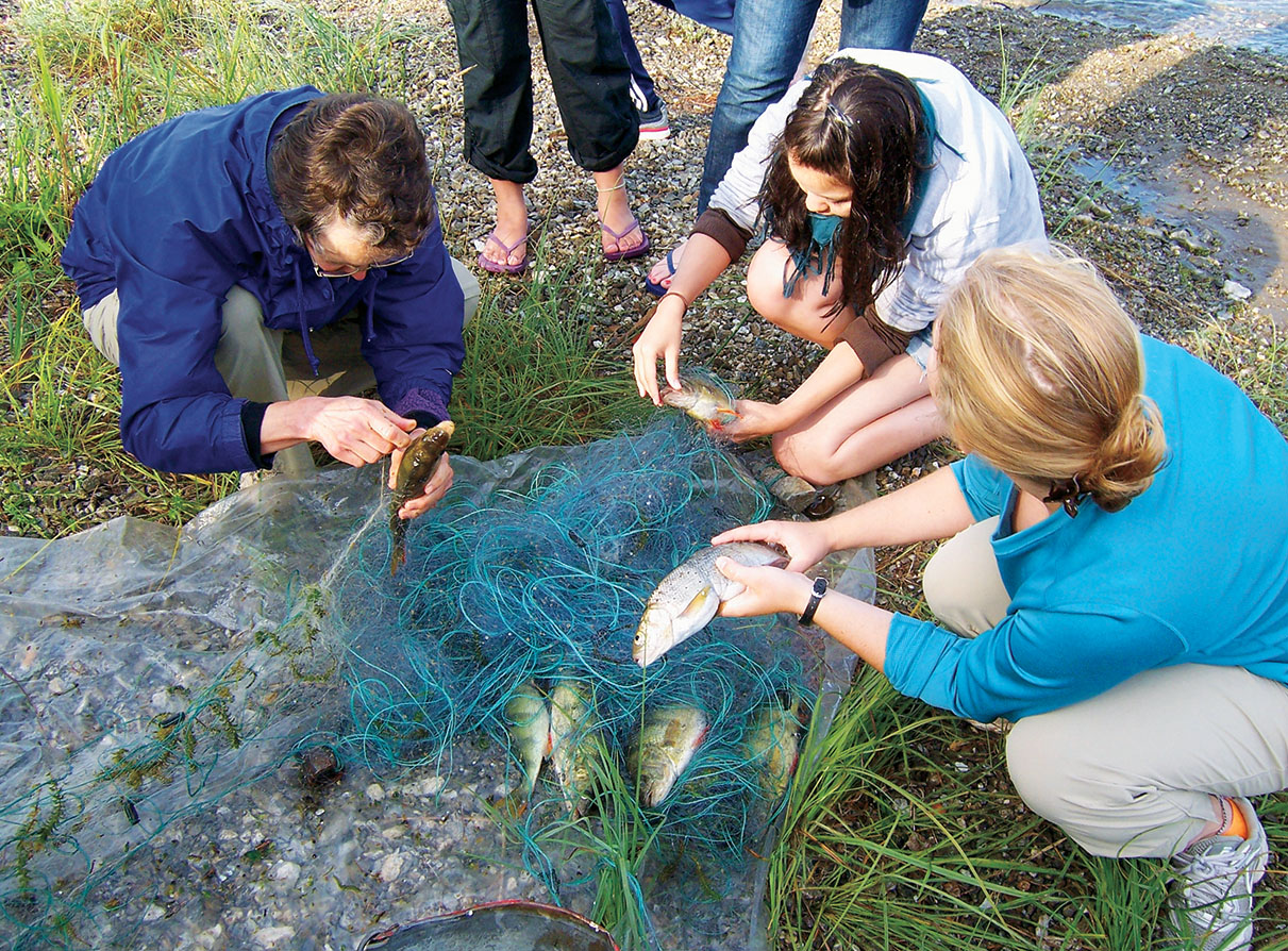 Moore and students remove fish netted overnight for their breakfast in 2013.