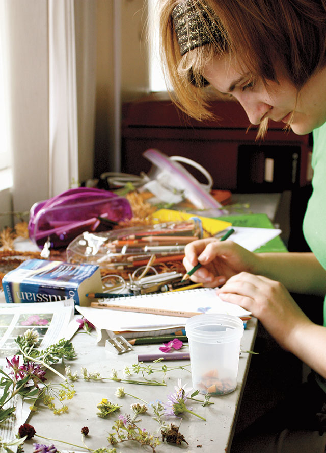 Xena Vronay Ruggles '15 identifies botanical specimens in the lab in 2011.