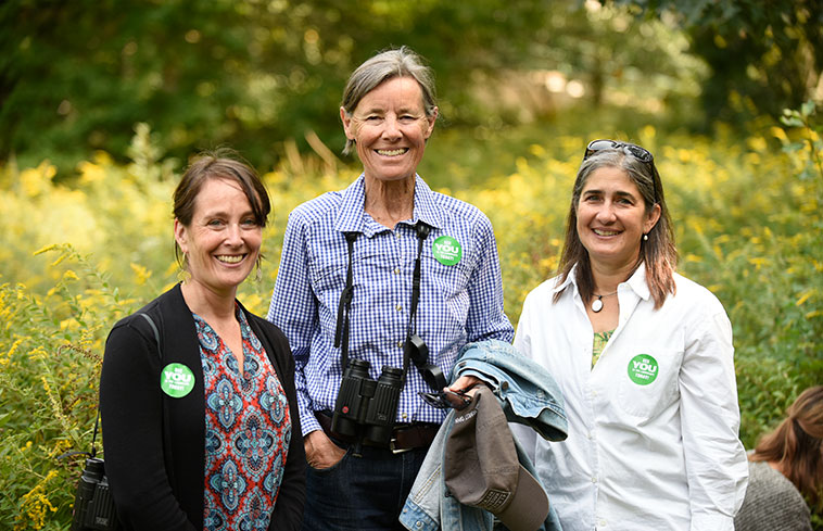 A photo of Suzanne Langridge, Wendy Judge Paulson '69, and Kristina Niovi Jones, taken outdoors on Sustainability Day.