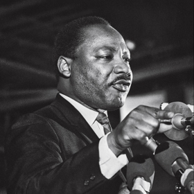 A photo of Dr. Martin Luther King, Jr., shows him speaking in Memphis on the eve of his assassination.