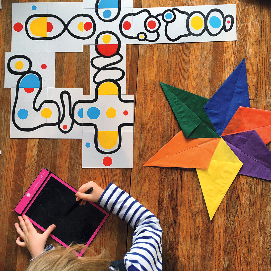 One of the author's children works on a large paper puzzle