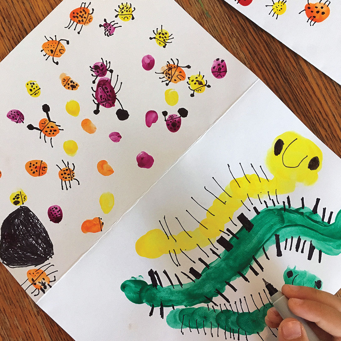 A photo of children's artwork featuring caterpillars