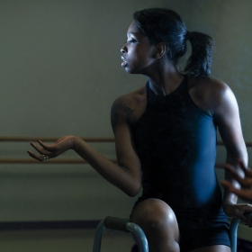 Ellice Patterson '16 dances in a studio with the aid of a walker.