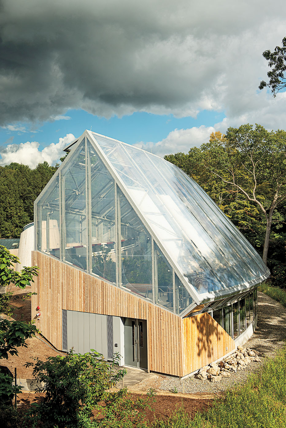 A photo shows the exterior of the new conservatory.