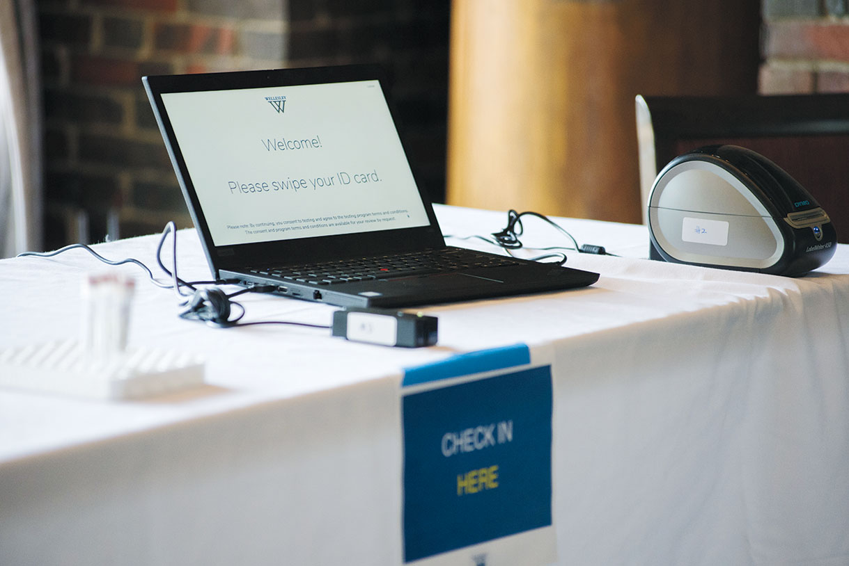 A sign-in laptop for COVID-19 testing in the College Club