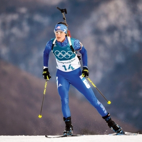 A photo of biathlete Clare Egan '10 cross-country skiing during the 2018 Winter Olympics.