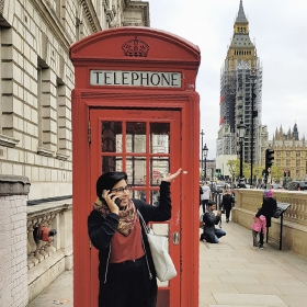 Sidikha Ashraf '18 poses in front of a London telephone box
