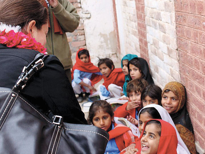 Berlow on a visit to Kujer Village in Pakistan