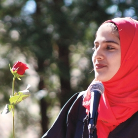 Maheen Akram '20 holds a red rose during faux-mencement.