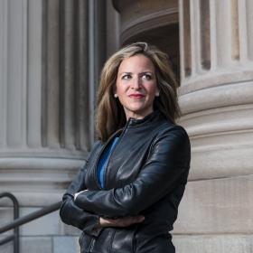 Jocelyn Benson '99 wearing a leather jacket