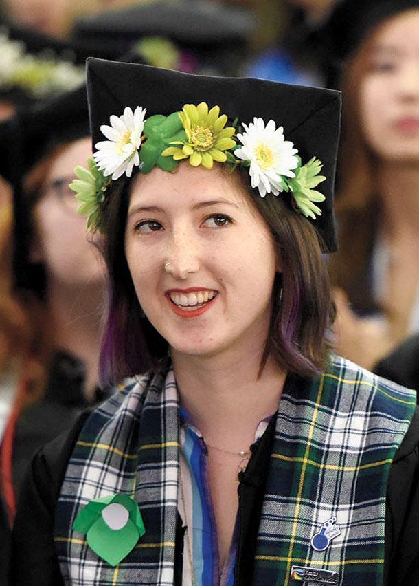 A student's tam is crowned with daisies