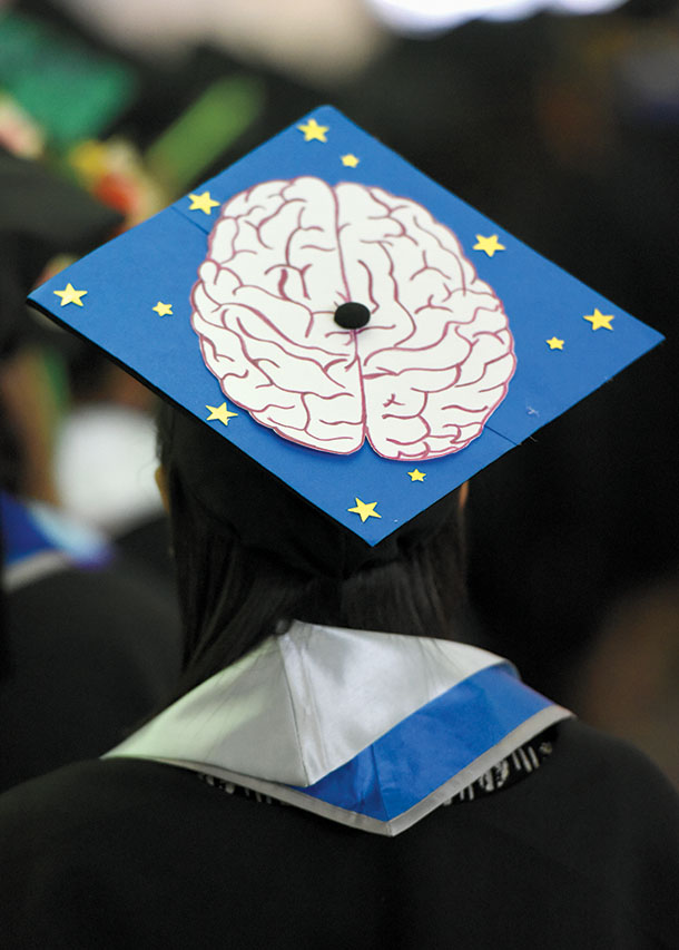 An image of a human brain decorates the top of a student's tam