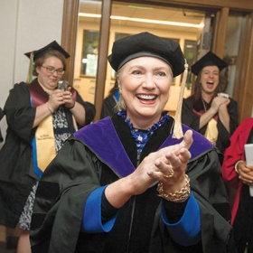 Hillary Rodham Clinton '69 and members of the class of '17 greet each other before Commencement.