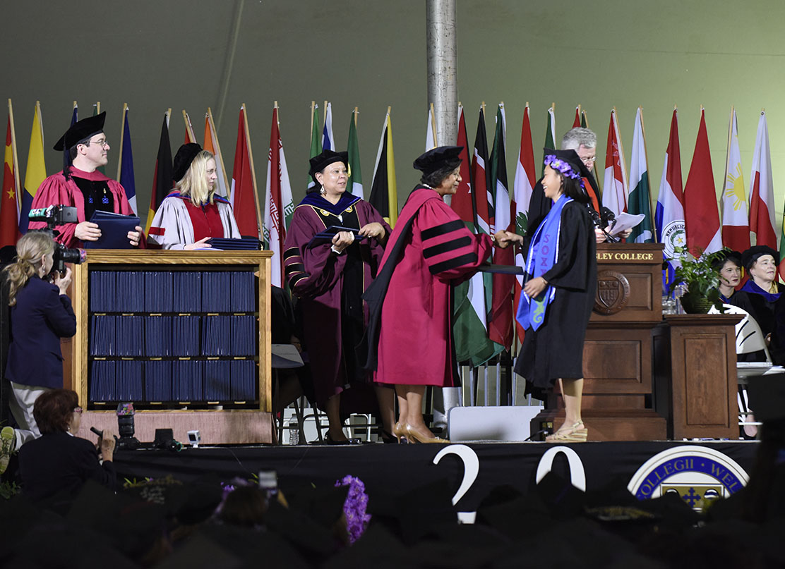 A photo of President Paula Johnson handing a diploma to a member of the class of 2018.