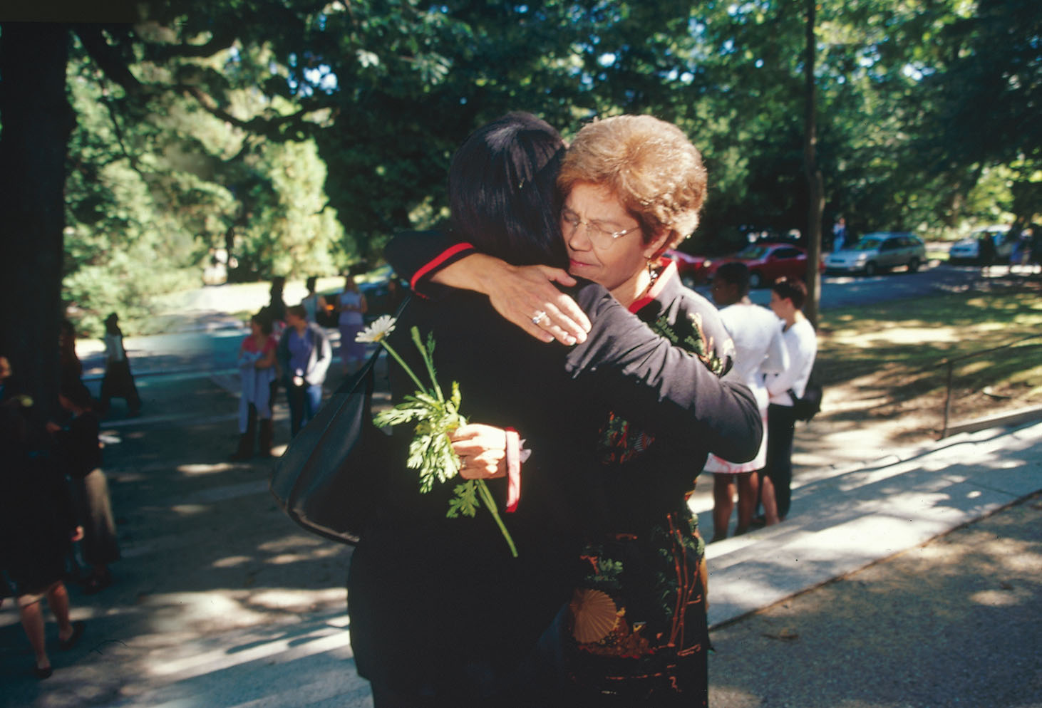 2001: President Diana Chapman Walsh '66 comforts a student at Flower Sunday, a few days after the 9/11 terrorist attacks.