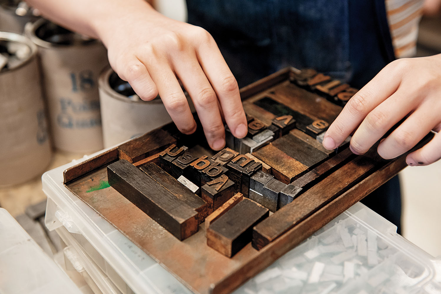 A student sets type in the Book Arts Lab, which celebrates its 75th anniversary this year.