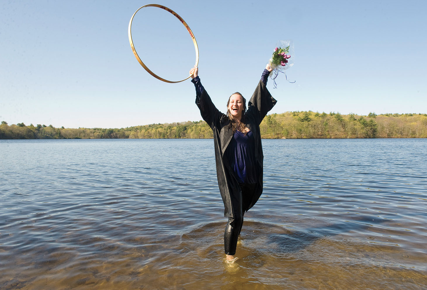 2010: Hooprolling winner Ashley Gramolini '10 celebrates with a dip in Lake Waban.