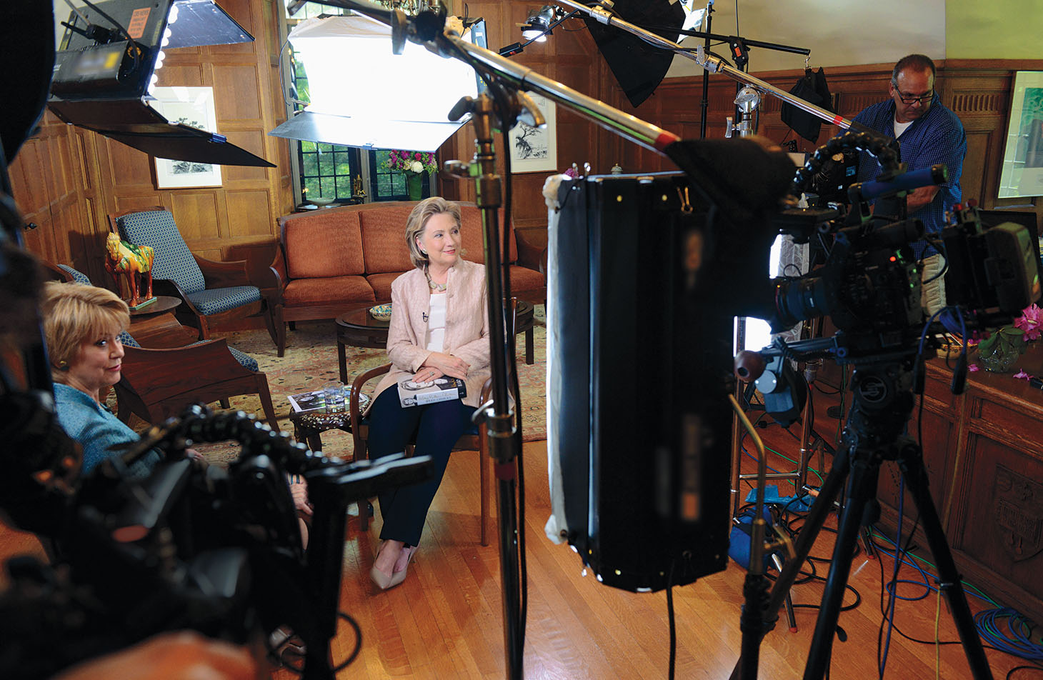 2014: Jane Pauley of CBS Sunday Morning and Hillary Rodham Clinton '69 prepare for a television interview in the president's office during reunion 2014.