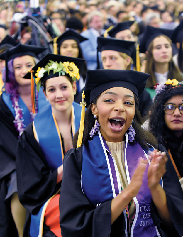 Students cheer during commencement
