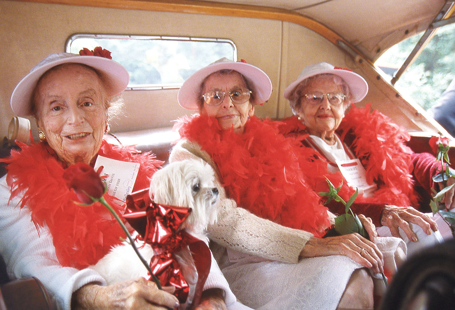 1998: Wellesley Trustee Kathryn Wasserman Davis '28 (left) and classmates Marjorie Scoboria and Trustee Harriet Segal Cohn awaiting the start of the alumnae parade in an antique car at their 70th reunion
