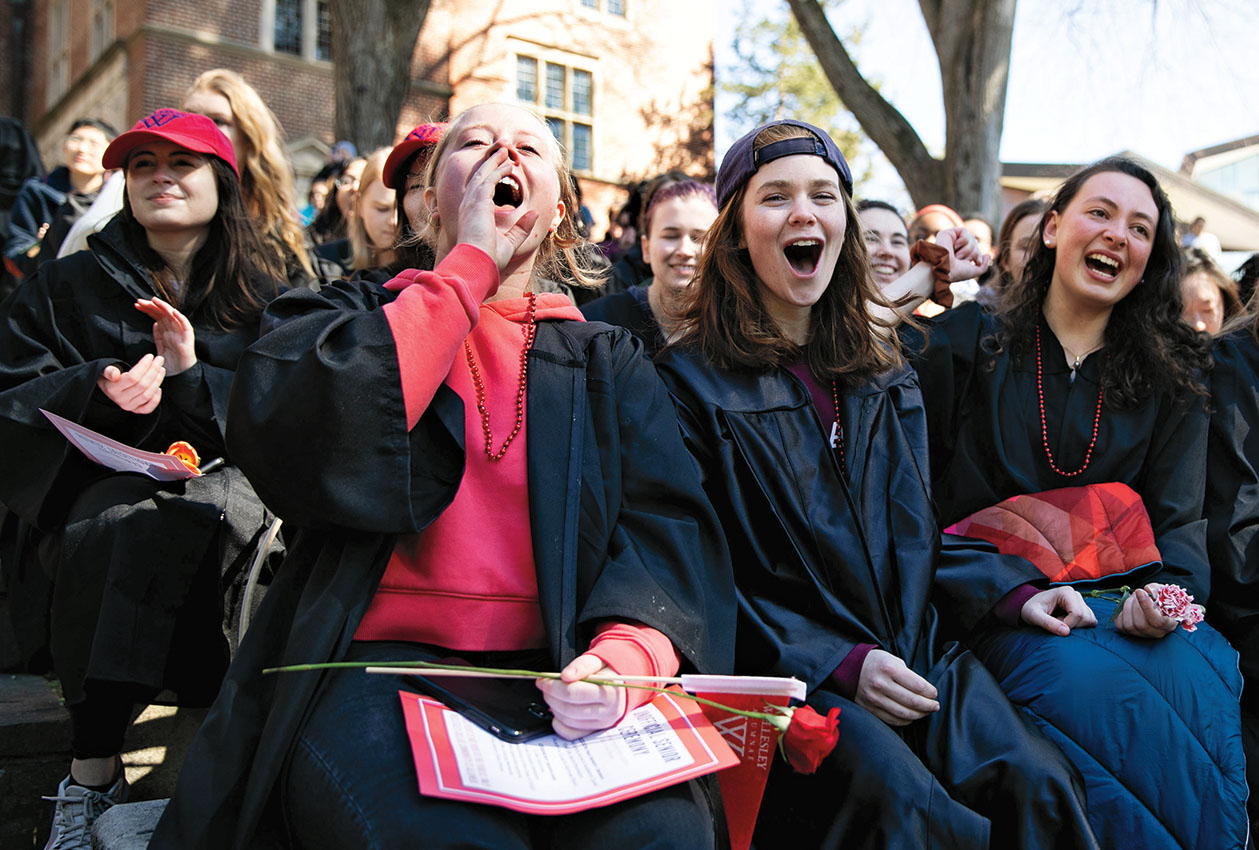 Students cheer at the faux-mencement ceremony they organized