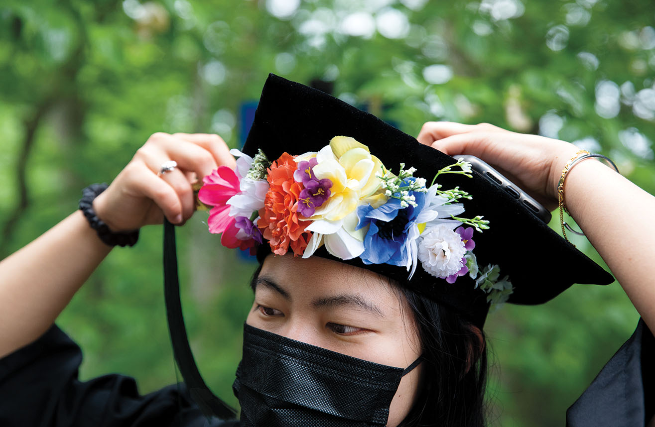 Lucille Tsao '21 adjusts the tassel on her tam before the ceremony.