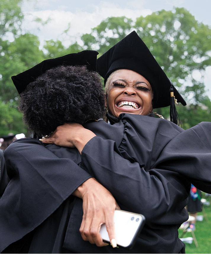 Asha Colbert '21 and Shanez'e Johnson '21 hug after commencement.
