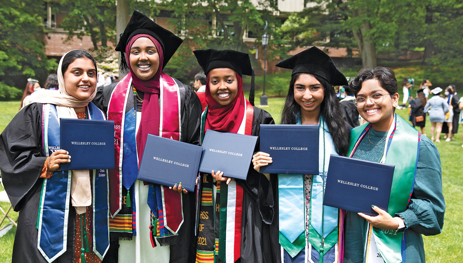 A group of students proudly display their diplomas.