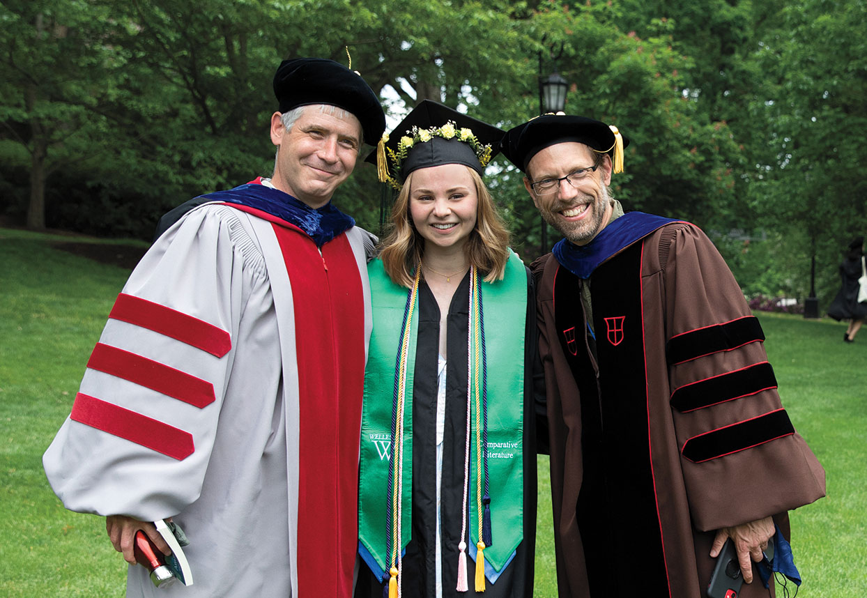 Faculty members wore full academic regalia for the commencement exercises. Many seniors wore stoles, and flowers.