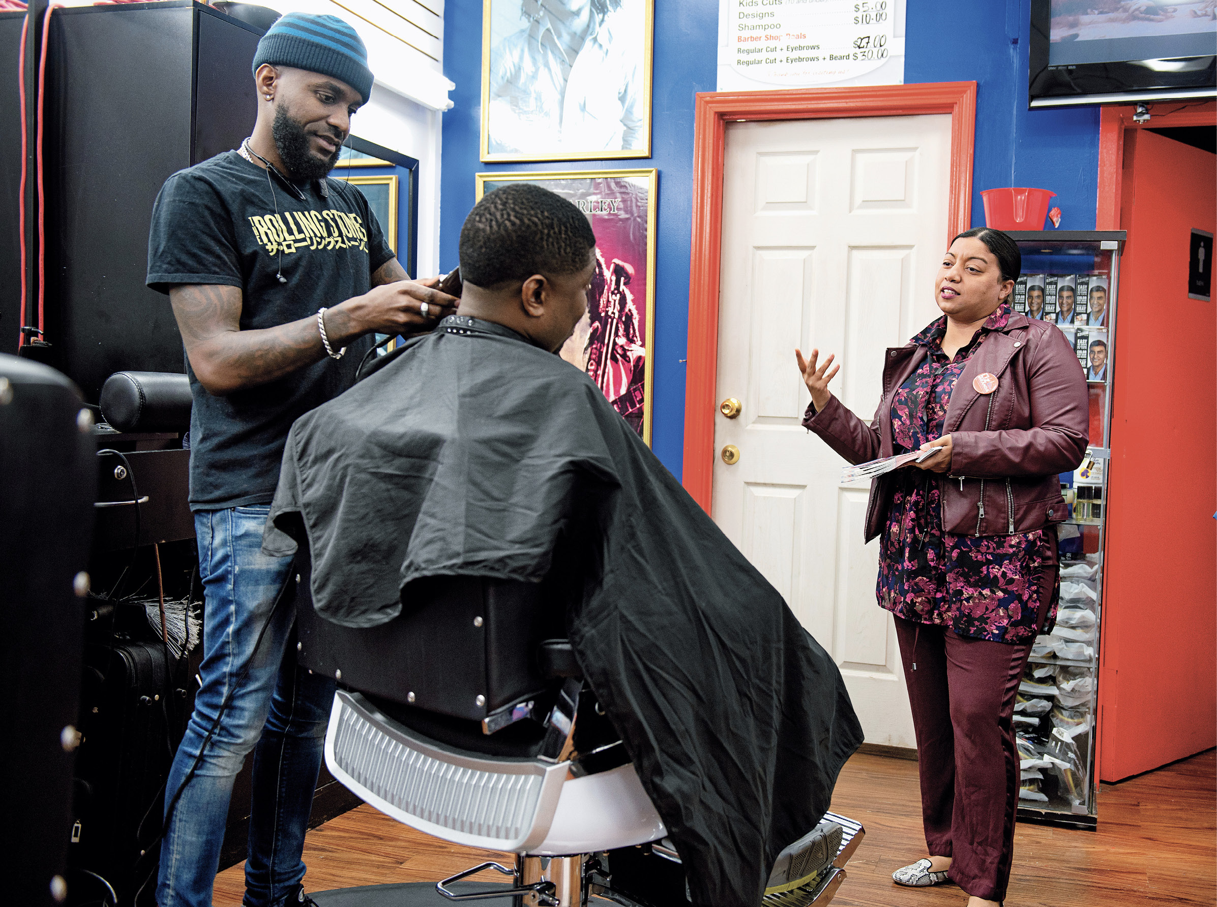 Miranda speaks with constituents in a barber shop