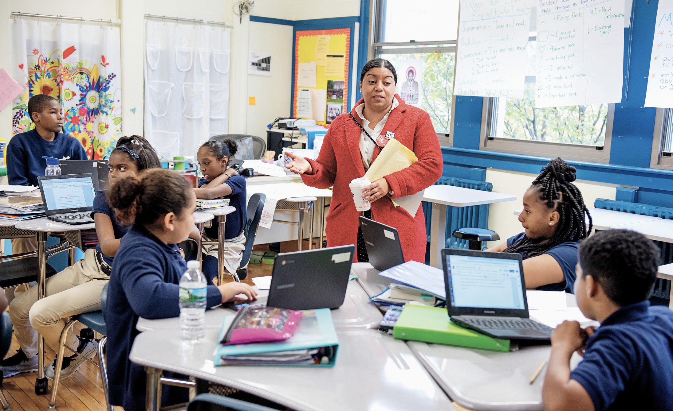 Miranda speaks with kids in her district