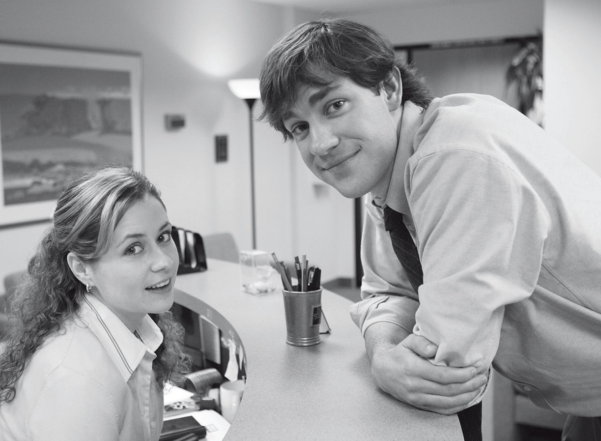 Coworkers-turned-couple Pam and Jim on The Office.