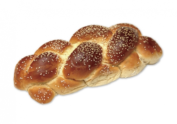 A photo shows a loaf of braided challah scattered with sesame seeds.