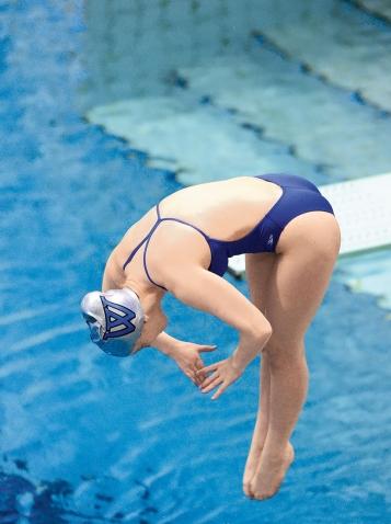 Maura Sticco-Ivins '18 doing a dive
