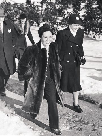 Photo of Mayling Soong Chiang 1917 (Madame Chiang Kai-shek) visited campus while wearing pants and a fur coat