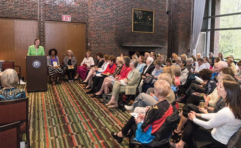 An audience gathered in the College Club for an Authors on Stage event.
