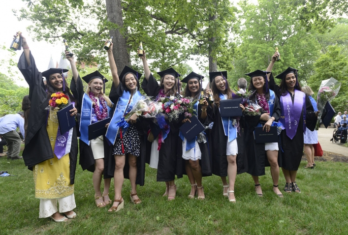 A photo of six new alumnae from the class of 2018 celebrate after the ceremony.