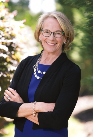 A photo portrait shows the new WCAA president, Laura Wood Cantopher '84, wearing a Wellesley-blue top.