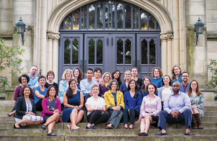 Photo of Career Education staff sitting on the steps of Green Hall