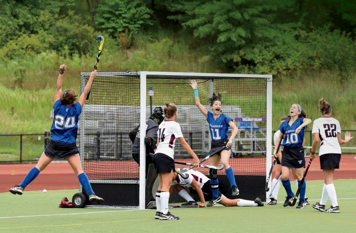 A photo shows Arielle Mitropoulos '19 (#11) and Julia Rappaport '22 (#10) jumping for joy as Sophia Albanese '21 (#24) scores her first collegiate goal in a 5–0 win over the University of Maine at Farmington this past September.