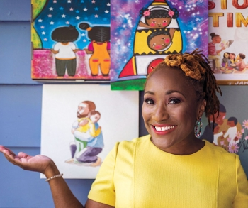 A photo of Mijha Butcher Godfrey '99, the founder of the Jambo Book Club, with artwork from diverse children's books in the background