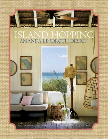 "The cover of ""Island Hopping"" shows a seaside living room open to the sun and air, filled with casual furniture and a wicker swing."