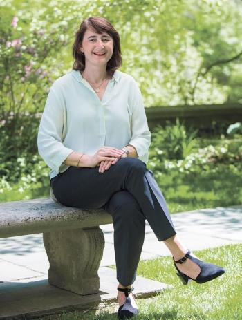 Martha Goldberg Aronson '89, president, Wellesley College Alumnae Association, sits on a bench outside Green Hall