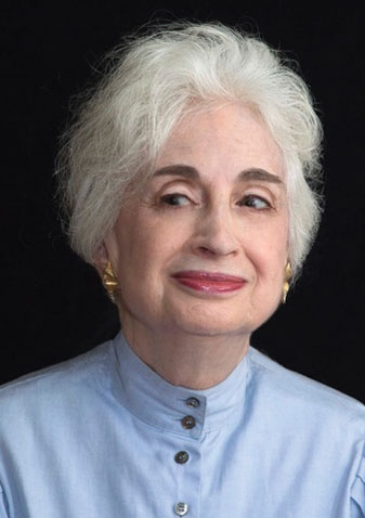In a photo portrait, Judith Perlman Martin '59 smiles sardonically.