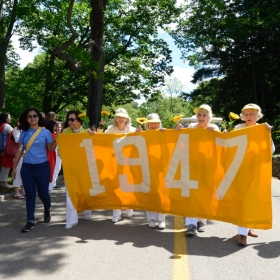 The Class of 1947 holds their yellow banner
