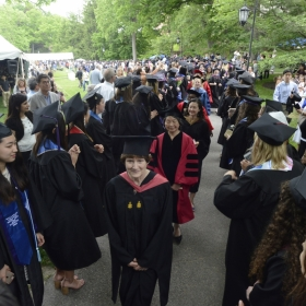 A photo of the faculty procession nearing the tent on Commencement day