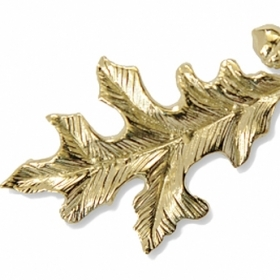 Gold oak-leaf pin given to Alumnae Achievement Award recipients