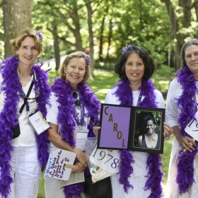 Class of '78 friends carried a photo of their friend and classmate Carol Allen, who died in March, in the alumnae parade. Pictured are Mimi Mengis, Elaine Claar Campbell, Susan Yee Jong (holding the photo of Carol), and Janie Schwab.