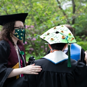 Students embrace at Commencement